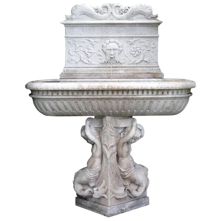 "An exceptional carved marble lavabo, or wall fountain, comprised of three pieces, the backplate with lapidary script reading ""LAVAMINI,"" meaning ""to wash,"" ornamented with stylized dolphins, floral rinceaux, and a central ""Green Man"" mask piped for water, the lozenge form basin with semi-lobed bowl and stiff leaf motif on rim, Northern Italian or Venetian, Renaissance period, 1485-1500"