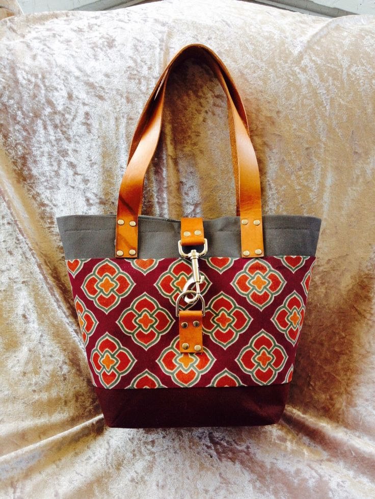 Waxed canvas and leather Handbag - Orange, maroon, rust and gray purse - clutch tote bucket bag by CuttingEdgeQuilting on Etsy https://www.etsy.com/listing/237077199/waxed-canvas-and-leather-handbag-orange
