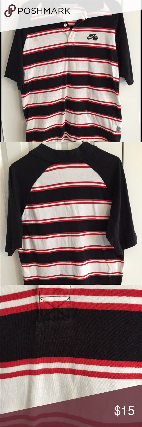 Men's Nike Polo Shirt Black, red and white striped Nike Air polo shirt. Very faint yellowish stain on front in the center - at bottom stripe in photo #3. Some normal wash wear/slight graying of collar as seen in photo #4. 100% Cotton. Smoke free/pet free home Nike Shirts Polos