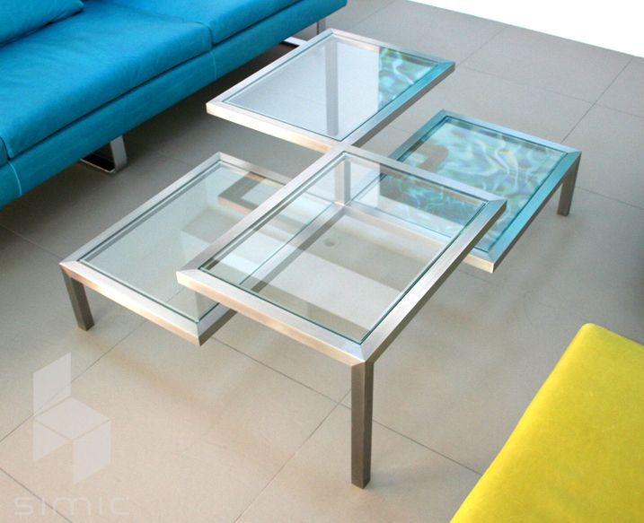 Simic's Nivoi 4 Coffee Table is a stainless steel multi-level table frame with clear polished glass panels. #design #interiordesign #interiordesignmagazine #productFIND #furniture #tables #glass #steel