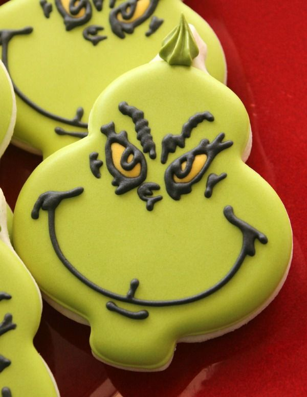 Decorated Grinch cookies with an ornament cutter by Sweet Sugarbelle