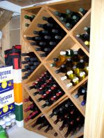 wine rack -- filled with bottles http://www.van-vliet.org/dempseywoodworking/winerack.shtml