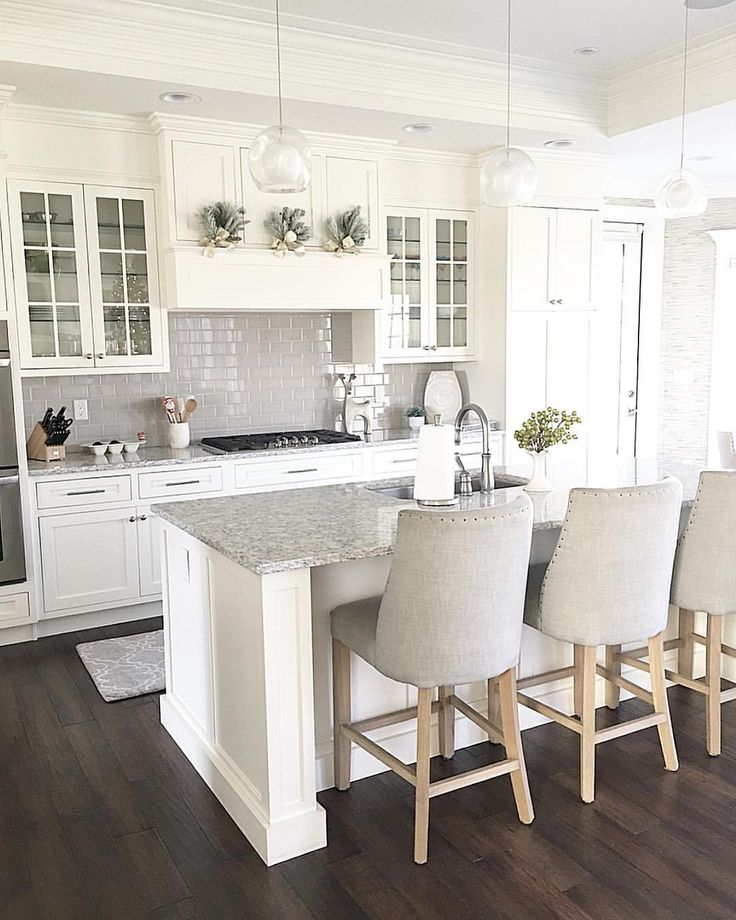 @carolineondesign White kitchen shaker cabinets with grey subway tile backsplash. Glass front cabinets. Neutral Christmas decor.