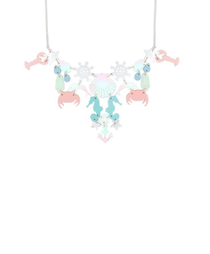 Underwater Necklace - Make a splash with the Underwater Necklace. Dive beneath the surface on the ocean and discover a magical world of marine life and treasure; dolphins swim with aqua seahorses and pastel pink crustaceans, while iridescent stars and jewels shimmer and shine. Layer over sequins for an under-the-sea style statement!