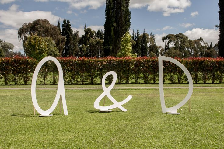 Wooden initial letters of bride and groom; used for guest pictures