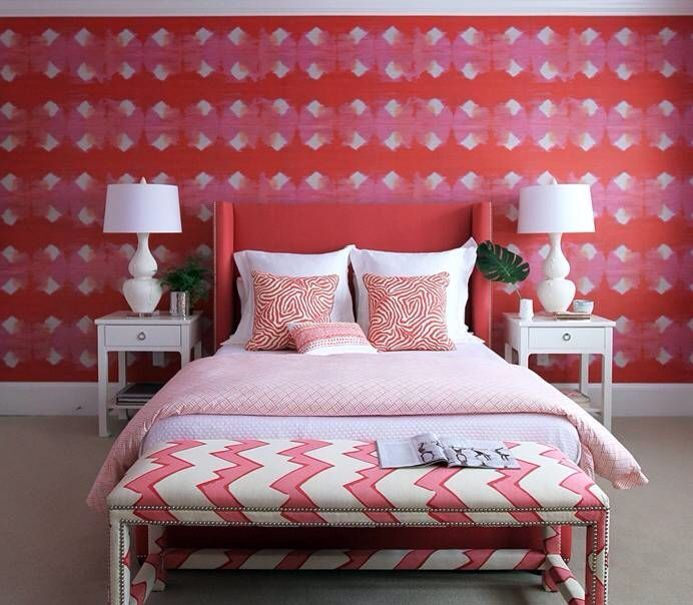 interior design bedroom in pink red and white colour palette white table lamps red