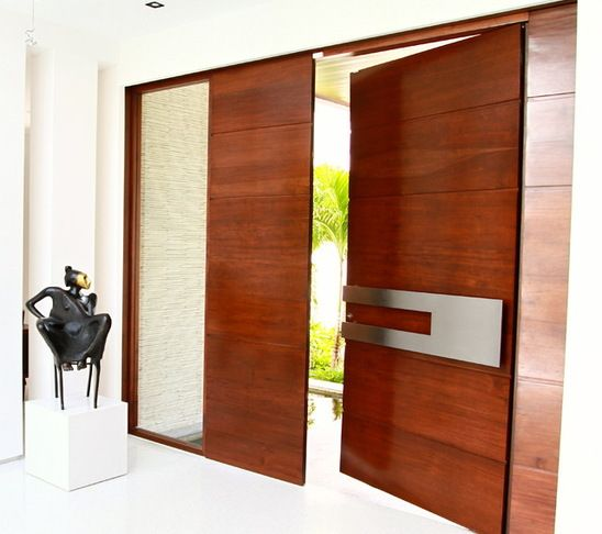 Contemporary Main Doors Borano Modern Doors - Modern doors with stainless adorning the door. The combination of shape, material and color is very suitable for this door.