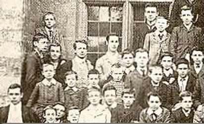 TEL Second row 4th from left in striped sweater) at City of Oxford High School for Boy, 1901.