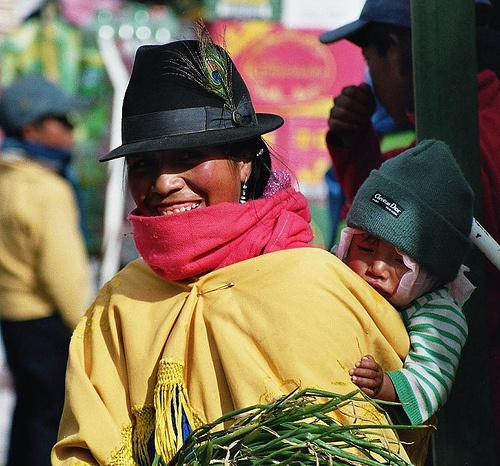 local carrying her baby on the back, Andean Market Ecuador (analog photography)
