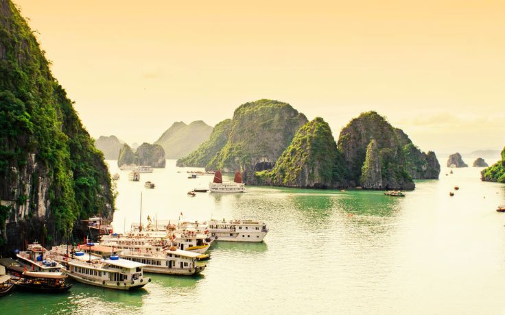 A vision of towering limestone rainforest islands surrounded by emerald-green waters, Hạ Long Bay in the Gulf of Tonkin, Vietnam, includes more than 1600 islands and islets, most of which are uninhabited. The area provides lots of interest for sightseers, scuba divers, rock climbers, and hikers alike.