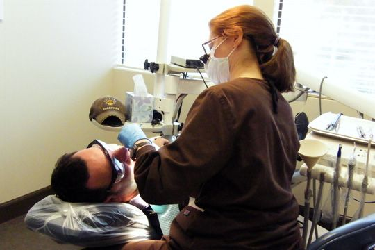 Our hygienist, Beth, treating a patient. #dentalhygienist #huntingtonbeach #huntingtonbeachdentist