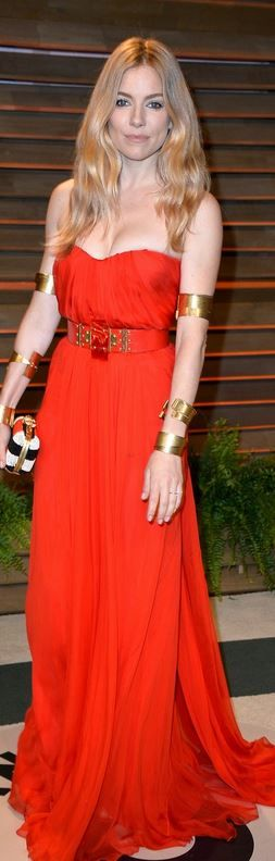 Sienna Miller: Dress, belt, jewelry, and bag – Alexander McQueen  Shoes – Dolce & Gabbana  Jewelry – Jennifer Fische