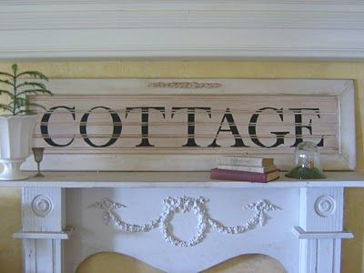 Cottage ~ love the sign & the mantel