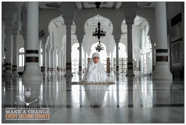 #9: 9-year-old Dara prepares for prayer inside Banda #Aceh's #Baiturrahman Grand #Mosque, which served as a haven for many who fled there for protection from the 2004 #tsunami/earthquake in #Indonesia. Inside, they were safe, subhanAllah. IR donors from around the world are sponsoring many children orphaned by the storm -- like Dara -- to help them receive vital support. (Photo credit: Tudor Payne for Islamic Relief)
