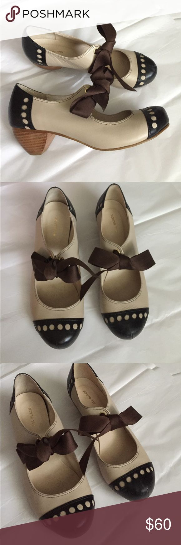 Anthropologie Oxfords! Anthropologie brand All Black Heeled oxford with tie! Black and cream with a brown Bow! Size 9.5.  Heel 2 inches! Gently used condition! Anthropologie Shoes Heels
