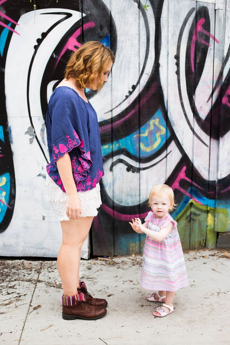 I love the southwest accents in this mommy and me outfit! Those striped cuffs in the brown boots? And that adorable striped toddler dress? Adorable!