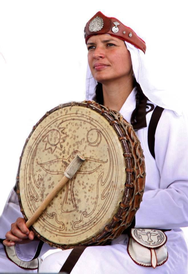 Hungarian female kam(shaman) drumming.