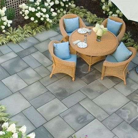 By using moulds to make your own paving bricks or paving for Design your own small garden
