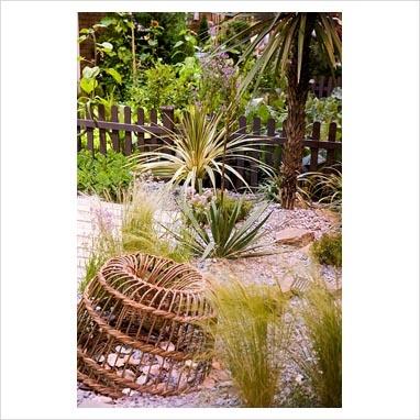 Coastal Garden with Armeria, Eryngium, Achilliea, Anchusa pebble mulch and a lobster pot