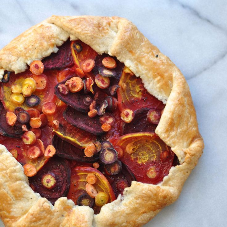 This recipe for a beet and carrot galette with gouda is rustic, earthy, and  delicious. It's easy to make, especially if you have a mandoline. I was  able to find a mix of colorful beets and carrots, and that helped make this  dish even prettier.  We had a good friend over for dinner this week