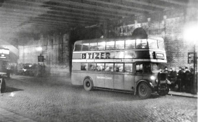 Buses under Greengate Arches, Salford, 1940s.