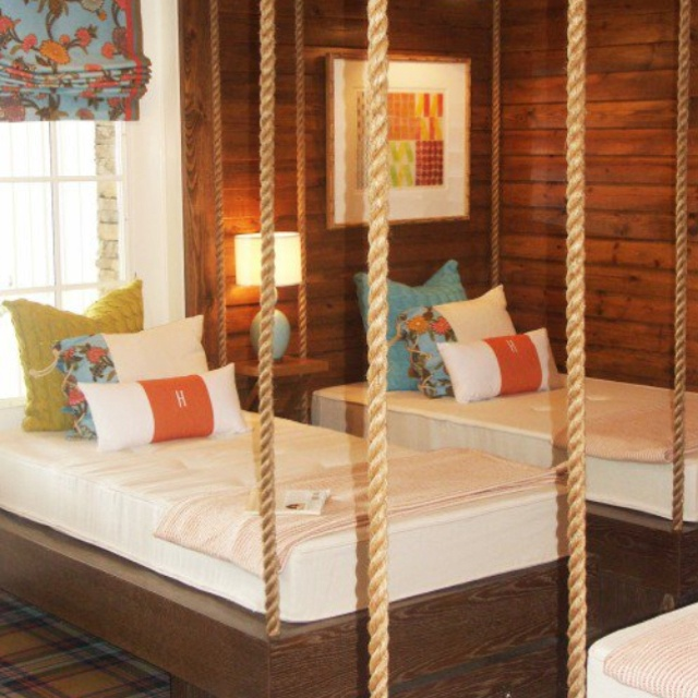 bunk room with hanging beds and nautical theme for the kids beach house