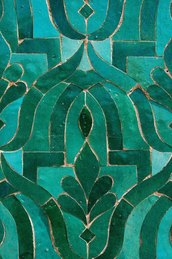 Teal green tiles in stylised floral forms