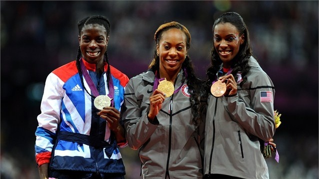 (L-R) Silver medalist Christine Ohuruogu of Great Britain, gold medalist Sanya Richards-Ross of the United States and bronze medalist DeeDee Trotter of the United States pose on the podium during the medal ceremony for the Women's 400m Final on Day 9 of the London 2012 Olympic Games at the Olympic Stadium