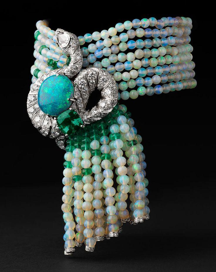 Cartier Luxuriant bracelet - Platinum, one 8.02-carat opal, one 3.43-carat chrysoberyl, one rose-cut diamond, opal beads, emerald beads, emerald eyes, brilliants. PHOTO Julien Claessens & Thomas Deschamps © Cartier 2012