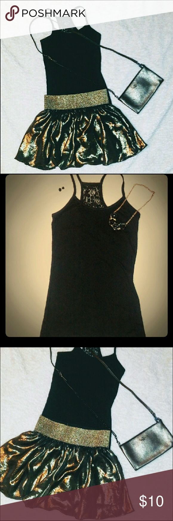 Outfit Bundle Forever 21 gold mini skirt and black racerback tank with lace detailing on back. Both are size small and both are true to size. Both are in excellent preowned condition. These two pieces are great together and can be styled with many things you already own as well. You could wear the tank with denim and fun heels. Items also sold seperately. See closet for additional pictures. Great value! Free gift with purchase Other