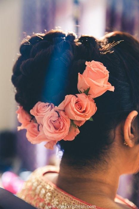Hairstyles For The Wedding - Semi Hair Pinned with Braided Bun and Pink Roses | WedMeGood #wedmegood #braid #bun #brides #hairstyles