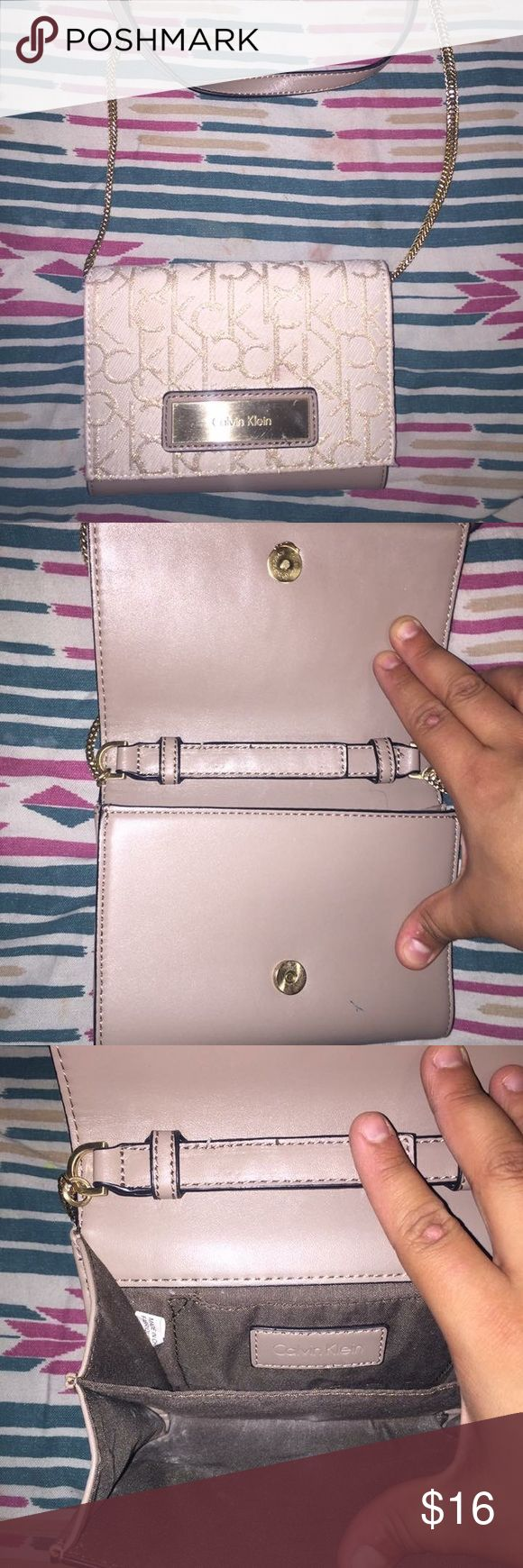 Calvin Klein Nude clutch Hardly worn Calvin Klein Clutch/cross body, there is nothing wrong with it. It looks used from the inside but from the outside is completely fine. I take reasonable offers. Calvin Klein Bags Crossbody Bags
