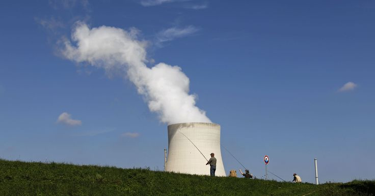Men are fishing on a sunny day near a cooling tower of the Isar nuclear power plant near Landshut, southern Germany, Sunday, Sept. 12, 2010. (AP Photo/Matthias Schrader)