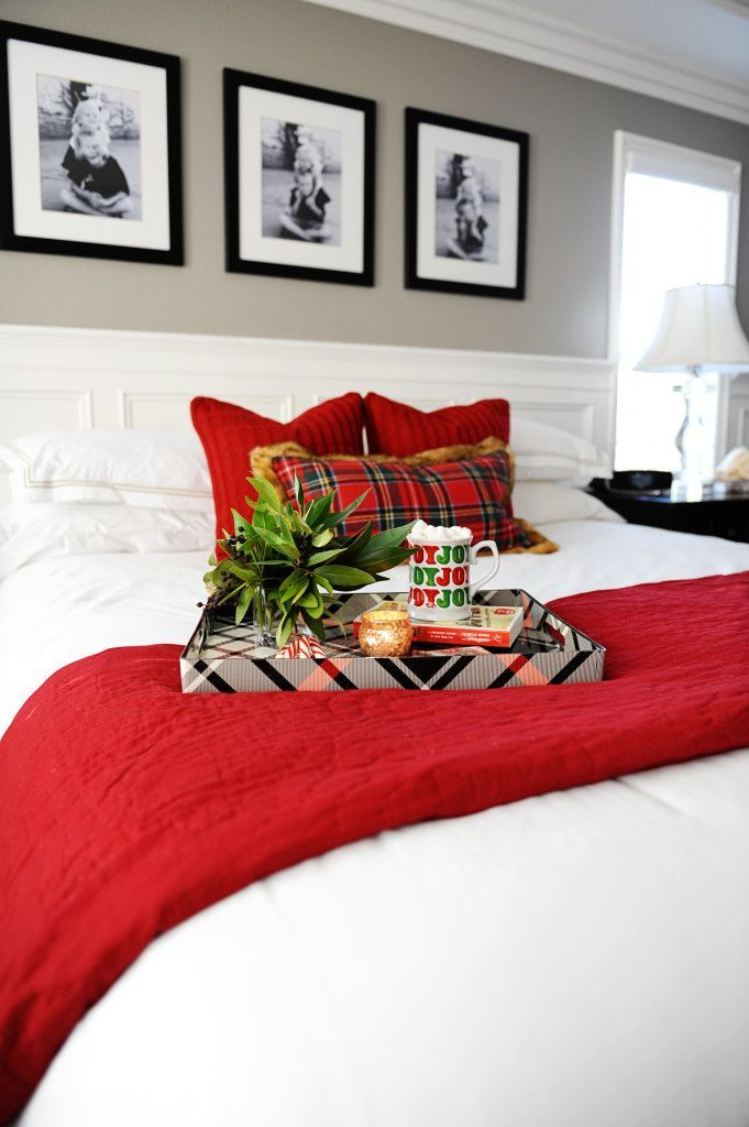 Red plaid and cable knit are a great pairing for a holiday-themed bedroom.