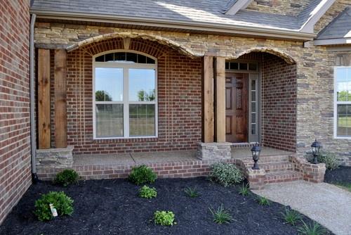 Rustic Columns And Red Brick Rustic Brick House Exterior
