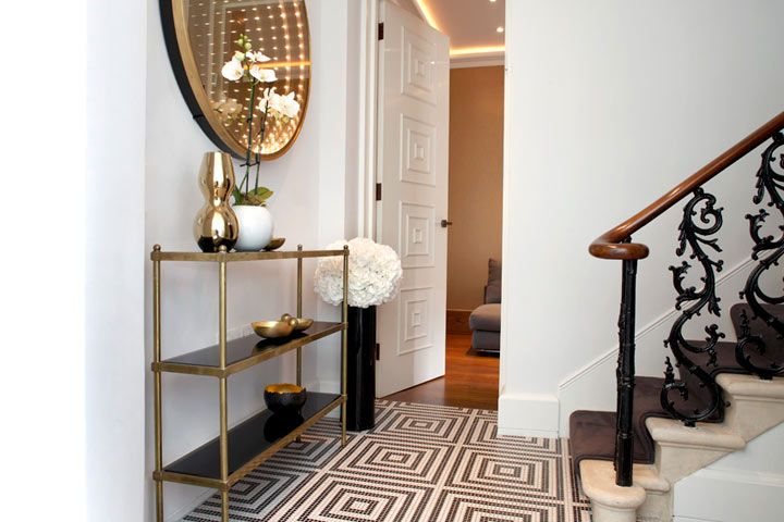 Carden Cunietti: Elegant foyer with brass console table ...