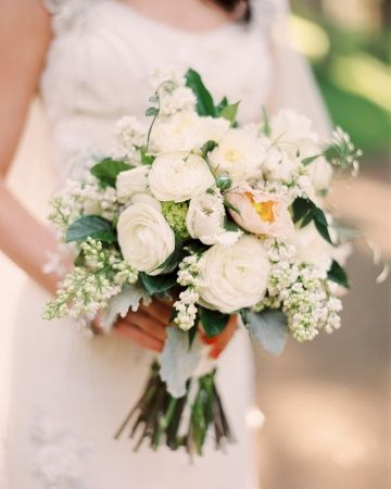 Loose, textured bouquet of lilacs, hydrangea, ranunculus and jasmine