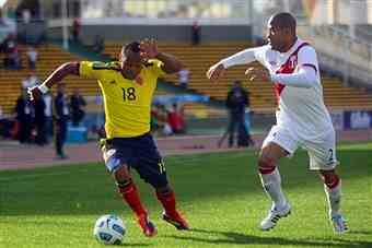 Colombia 0 Peru 2 aet in 2011 in Cordoba. Juan Zuniga runs down the line with Alberto Rodriguez tracking in the Quarter Final at Copa America.