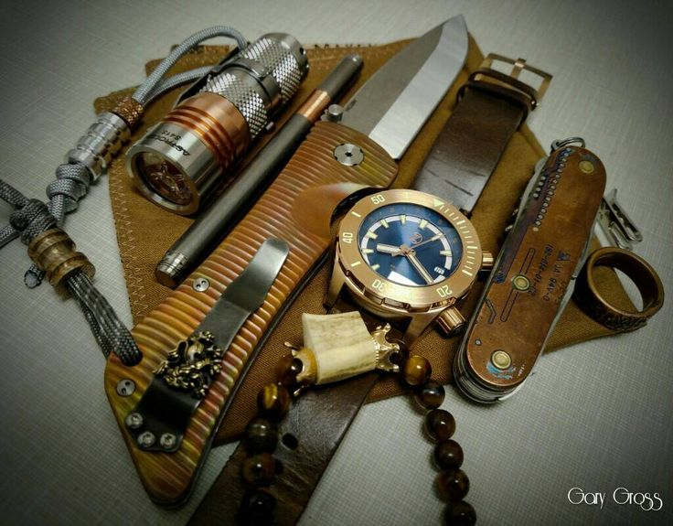 1.10.18 EDC  submitted by Gary Gross  Southern Grind Bad Monkey custom copper scales and tumbled blade  Steel Flame clip  Zelos Abyss 2 3000m Bronze Blue Dial  Astrolux S41S  Titanium pen with copper grip by The Right Choice Paining Company  Hammered copper ring  Tiger eye bracelet with antler by yours truly  Hank by Eden Ranch Accessories