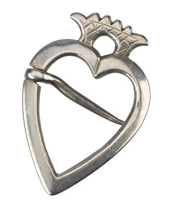 Silver heart brooch with a filled hatched crown, engraved with A . L and a maker's mark, C A, on the back of the crown, probably by Coline Allan of Old Aberdeen. Part of National Museums Scotland collection.