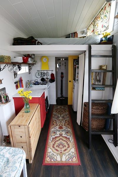 Standing at the front door: the kitchen, sleeping loft, and bathroom in the distance