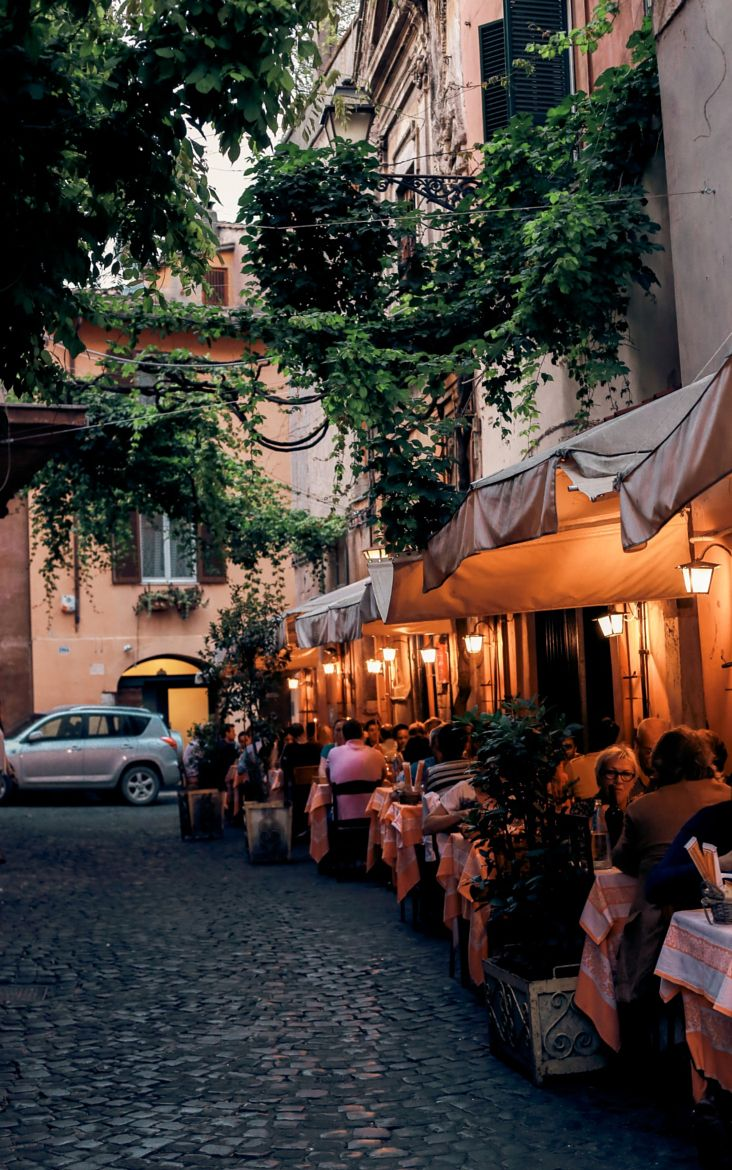 Trastevere, Rome. Enjoy a lovely meal at one of the restaurants that line the cobblestone streets. The Culture Trip will tell you all about The 10 Best Restaurants in Rome's Trastevere. (photo by: Laurais Arts)