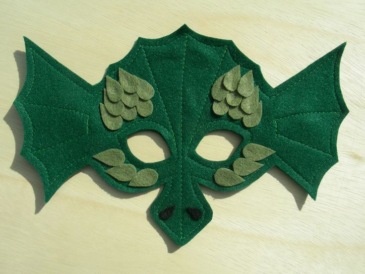 Child Size Dragon Mask to go with the wings!  from Mahalo on etsy.  Its a Merry handmade Xmas for us :)