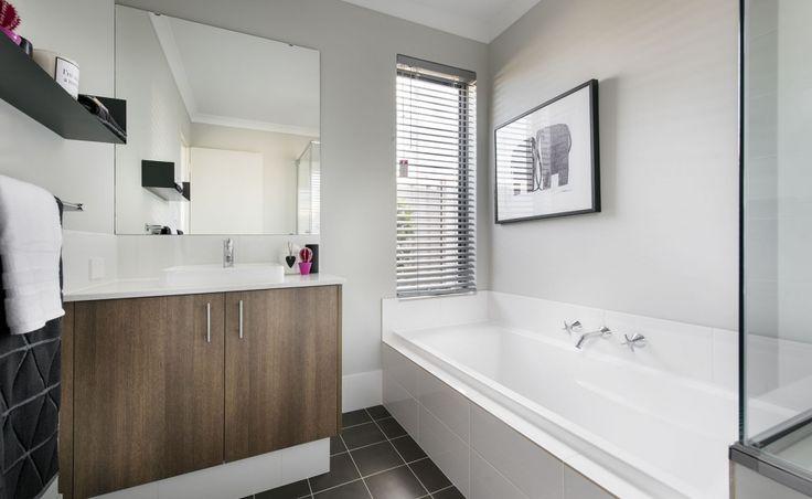 Stylish bathrooms with glass semi-frameless pivot screen doors