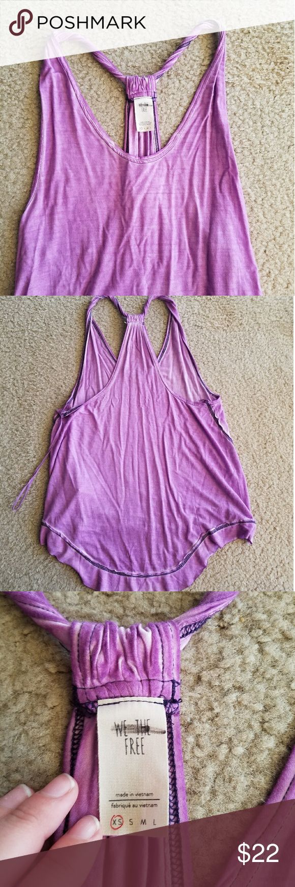 Free People Purple Tank New without tags racerback style tank top from the Free People brand we the free. A little longer in the back than the front. Size extra small Free People Tops Tank Tops