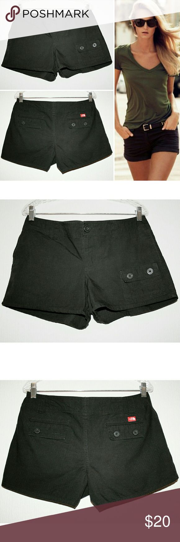 The North Face Black 5-Pocket Cotton Shorts These black shorts are both high-quality and stylish! The 100% cotton fabric is woven in a geometric square pattern, and the interlocking fibers add to their outstanding toughness and durability! They feature an asymmetrical patch pocket on the front left thigh, two regular front pockets that open from the sides, and two double buttoned flap closure back pockets. The back left pocket is missing 1 of 2 buttons, but extra are buttons attached to the…