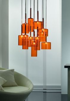 Get the best orange lighting and furniture inspiration for you interior design project! Look for more midcentury home decor inspirations at http://essentialhome.eu/