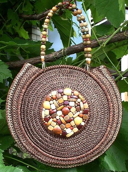 Crochet bags for inspiration.  Check out all the bags on the site for ideas to embellish these basic bags.