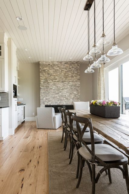 transitional gray dining room interior. Sherwin Williams Agreeable Gray paint color