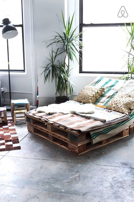 industrial daybed with a collection of berber rugs from Morocco.
